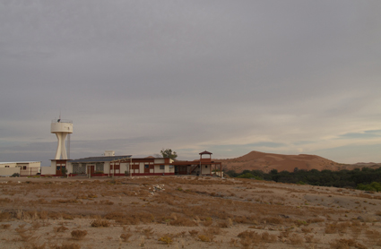Gobabeb Training & Research Centre with large sand dunes and Kuiseb riverbed in the background.